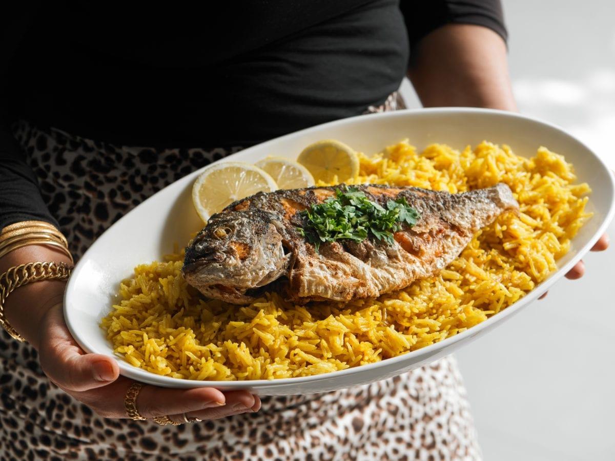Palestinian fish over yellow rice called sayadieh