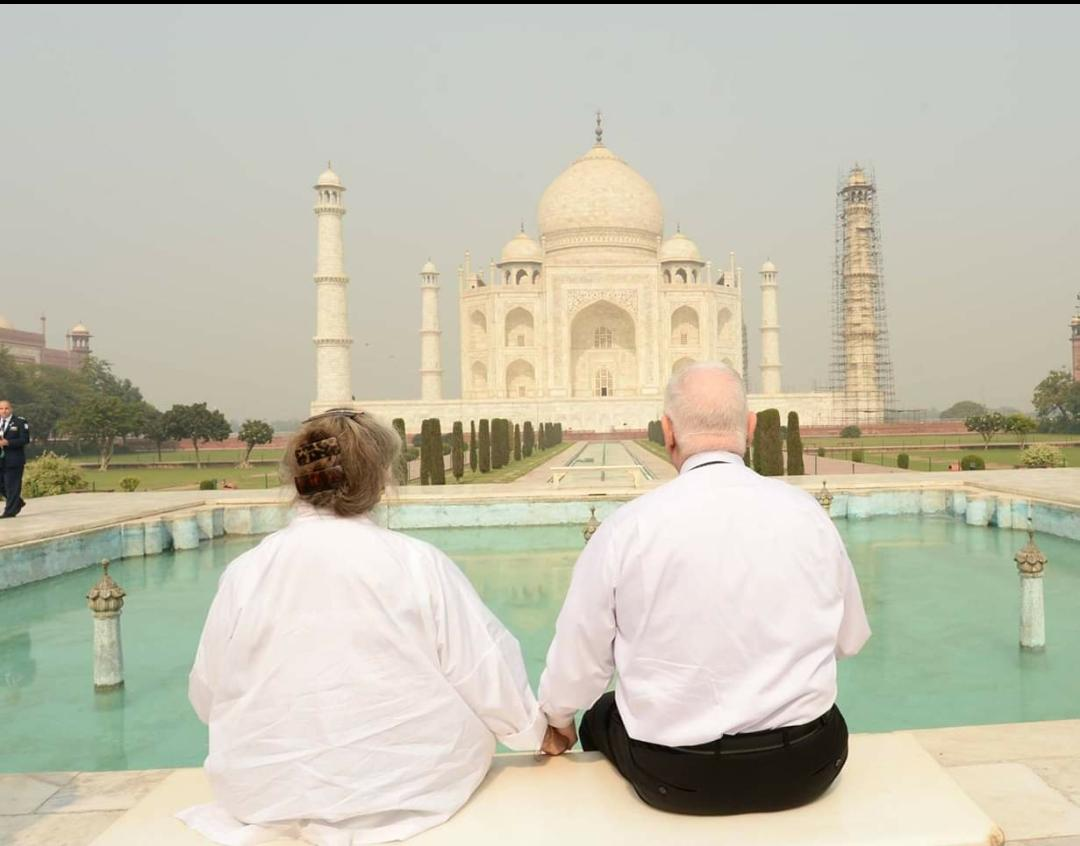 Nechama and Ruevain Rivlin in front of the Taj Mahal with their backs to the camera.