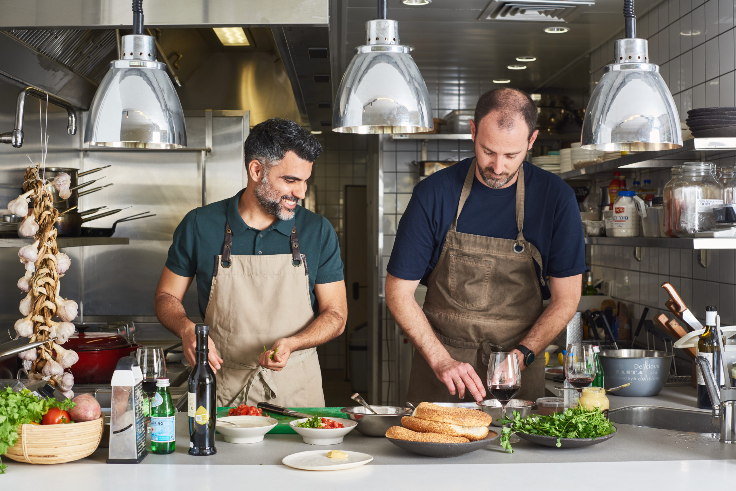 Matan Choufan and the founder of Redefine Meat cooking in the Asif test kitchen