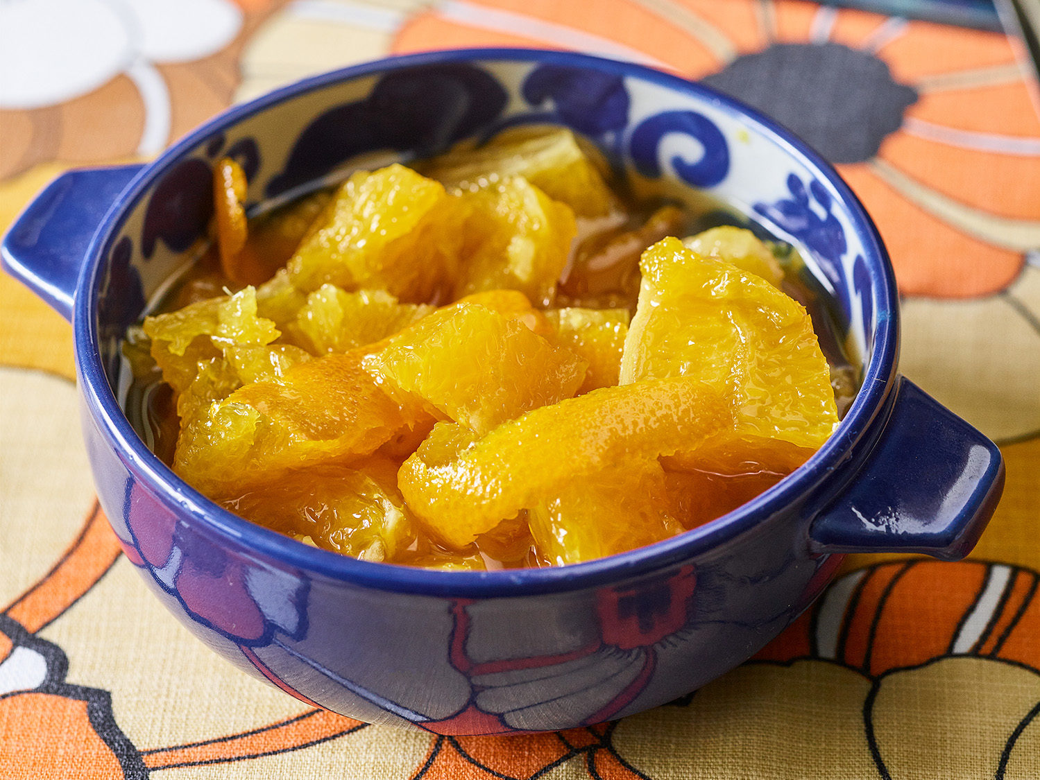 Orange jam in a blue and white ceramic bowl
