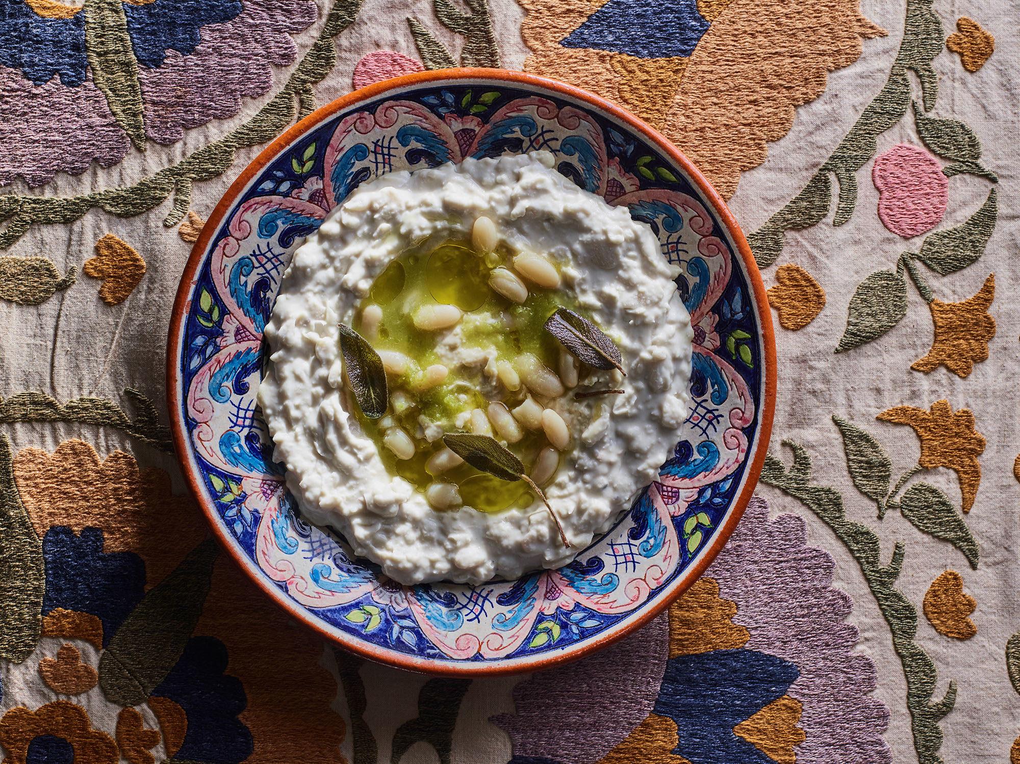 White bean masabacha in a ceramic bowl