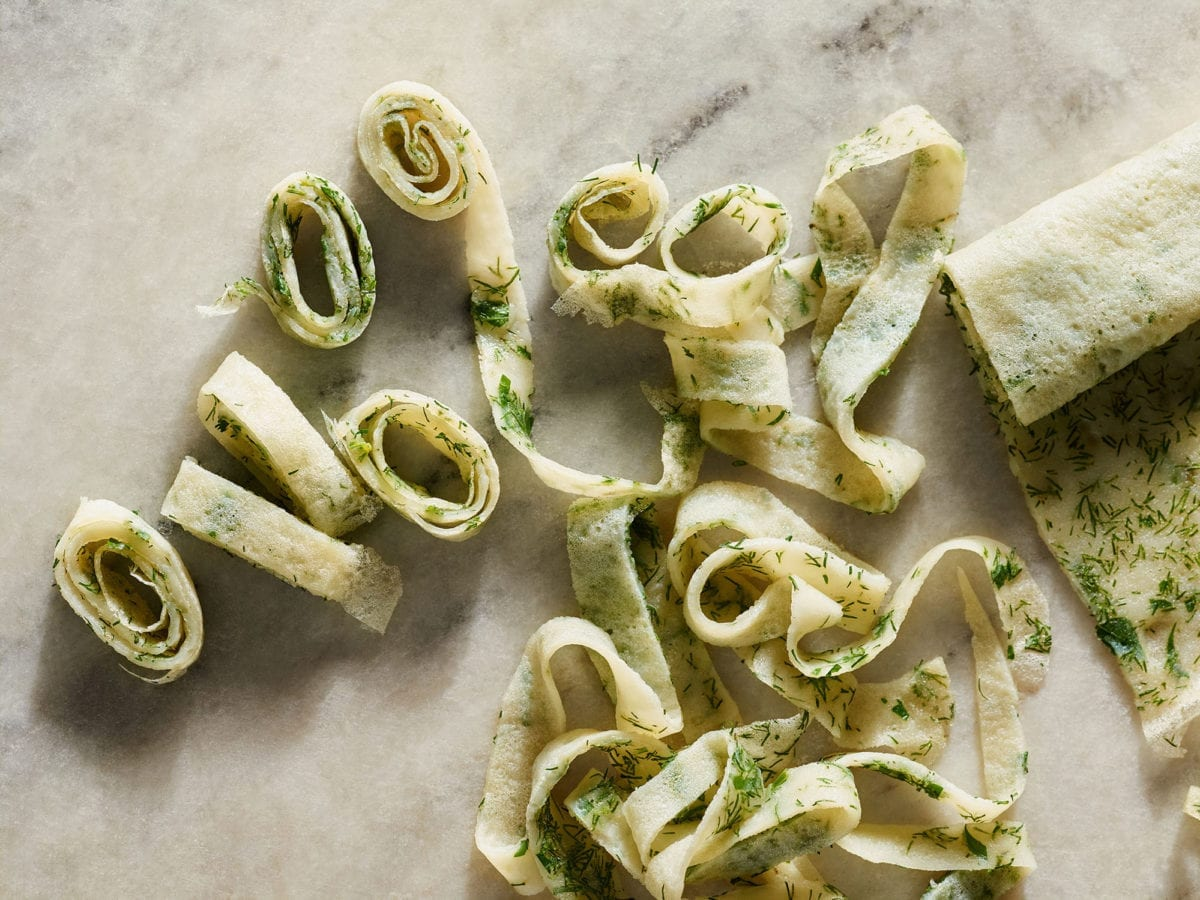 Fresh passover noodles with herbs on a marble counter