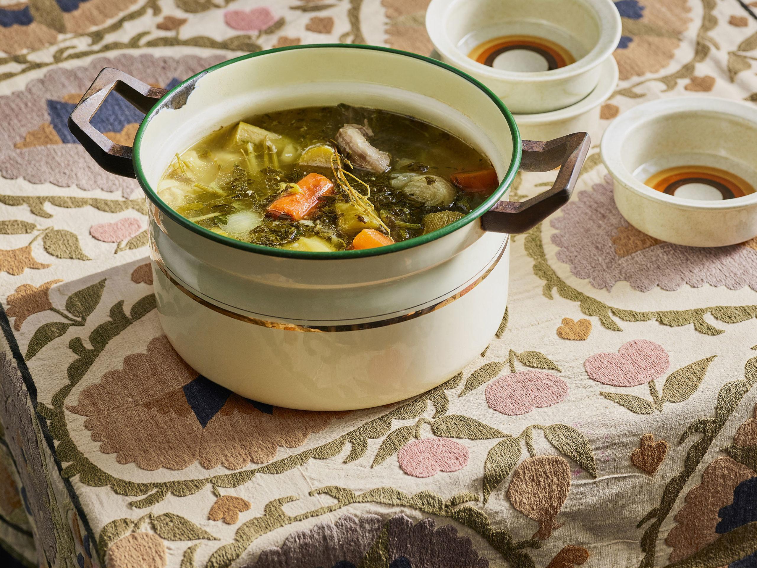 Nechama Rivlin's chicken soup in a cream colored crock pot