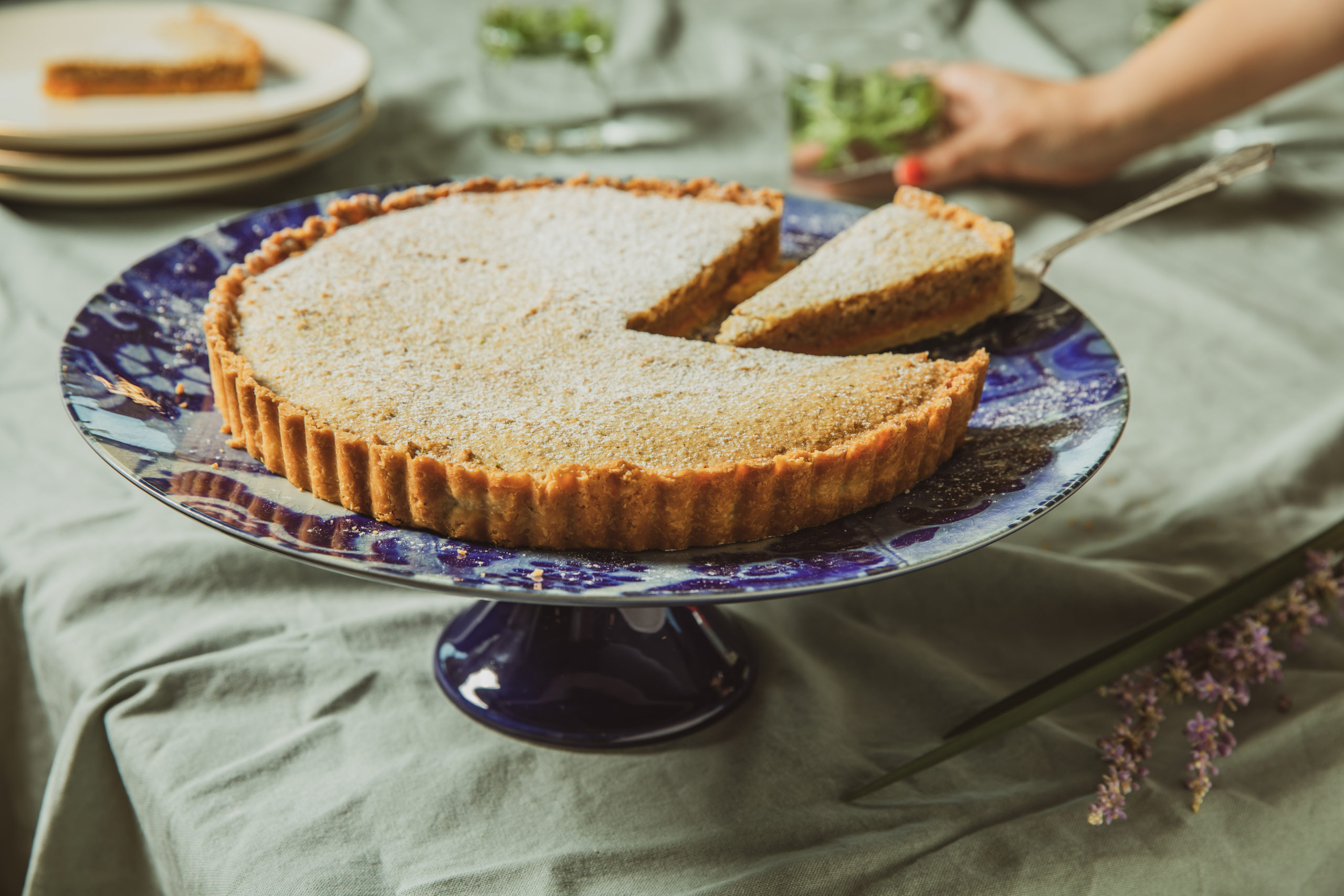 A Rosh Hashanah pumpkin jam tart on a blue and white serving plate