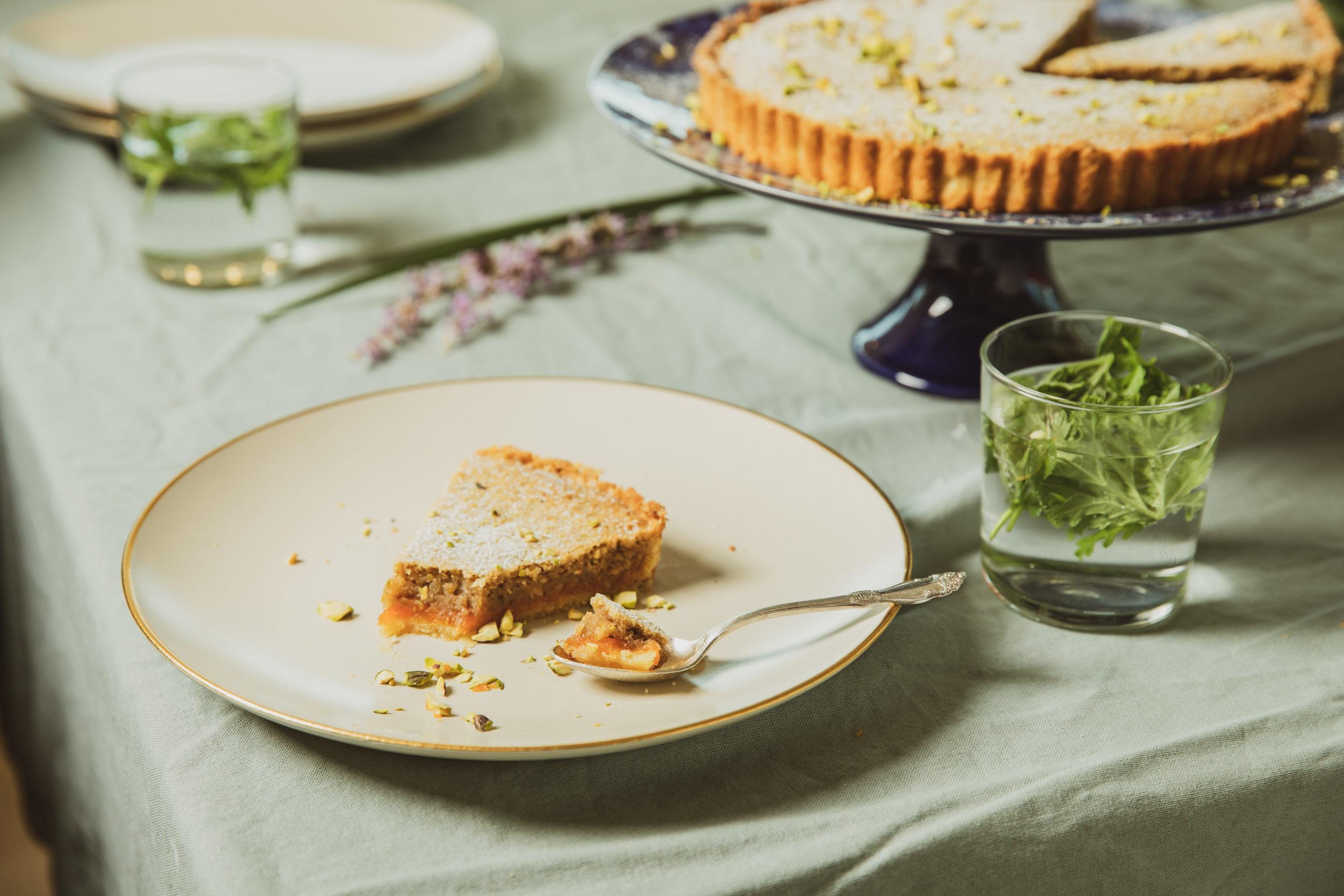 Slice of pumpkin jam tart on a cream colored plate