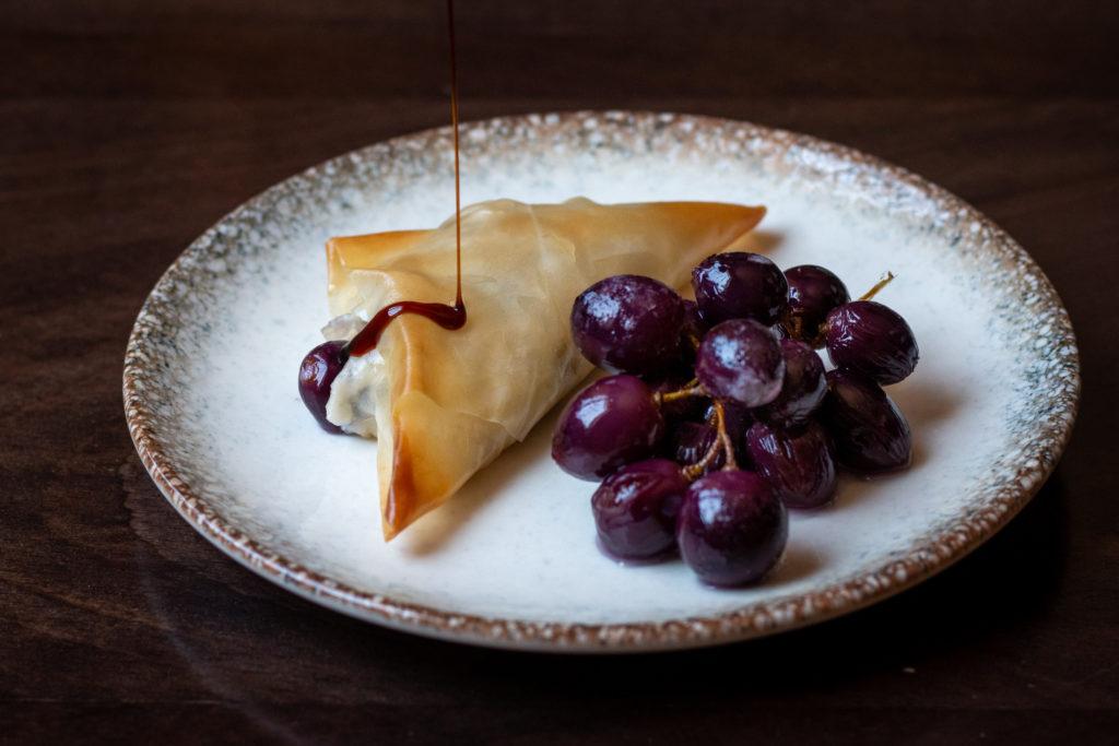 Filo triangles stuffed with kashta, grapes and raisins