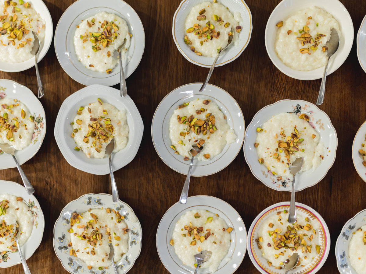 Bowls of rice pudding topped with pistachios.